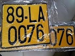 Xem xét giảm phí cấp đổi biển số xe sang màu vàng
