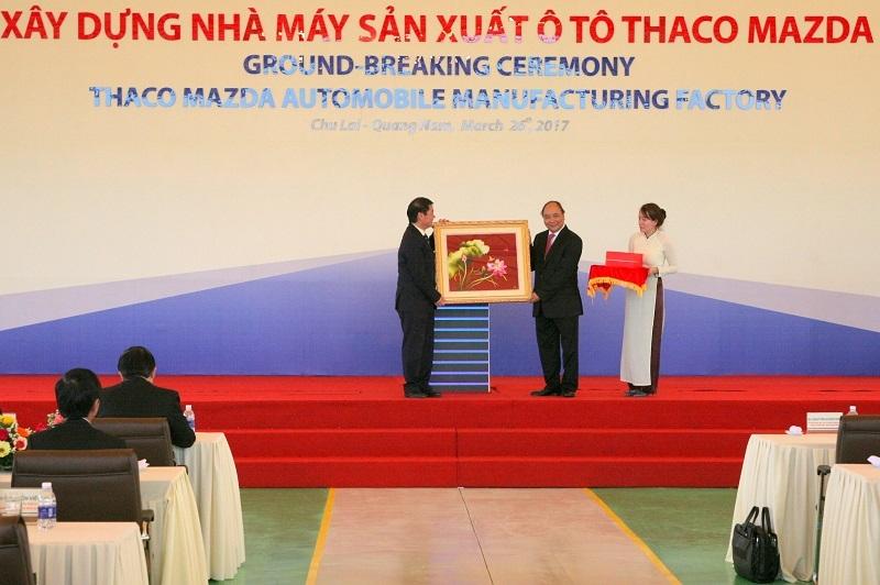thaco xay nha may mazda cong suat 100000 xenam